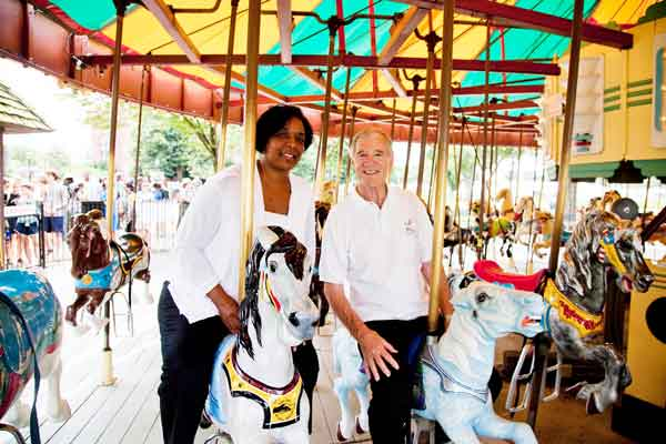 Sharon Langley, with carousel manager Stan Hunter, on the horse she rode 50 years ago. On Aug. 28, 1963, Langley was the first black child to enjoy the newly desegregated Gwynn Oak amusement park outside Baltimore.