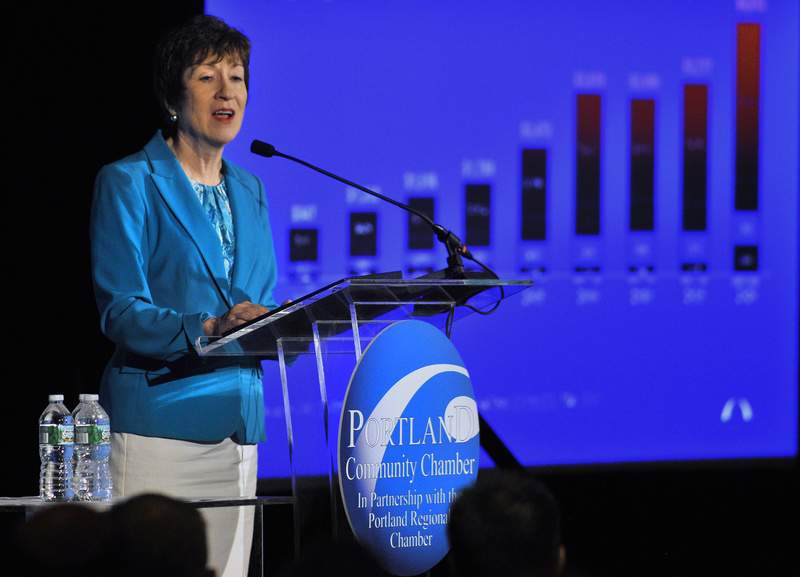 Sen. Susan Collins refers to a chart during her speech Thursday in South Portland.