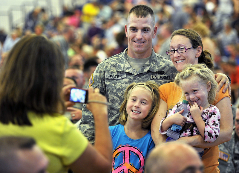 "Staff Sgt. Ryan Estes and his family pose for a photo before the start of Saturday's ""Hero's Send-Off Ceremony"" at the Portland Expo. He is a member of the a Maine Army National Guard unit that is deploying to Afghanistan. With him are his wife, Myra; and daughters Peyton, 8, left, and Dakota, 3."
