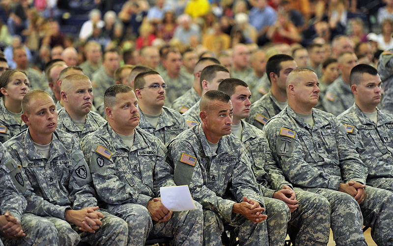 "Guardsmen listen intently as speakers thank them for their service during the ""Hero's Send Off Ceremony"" at the Portland Expo Saturday."