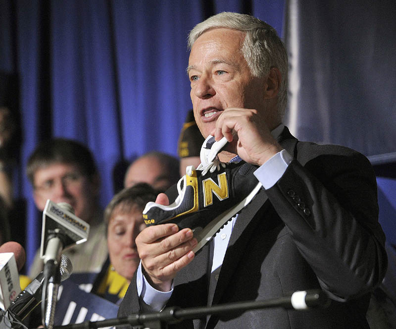 U.S. Representative Mike Michaud announced his candidacy for Governor at a press conference held at the Franco-American Heritage Center in Lewiston on Thursday. Michaud, a proponent of Maine made products, holds a pair of New Balance shoes.