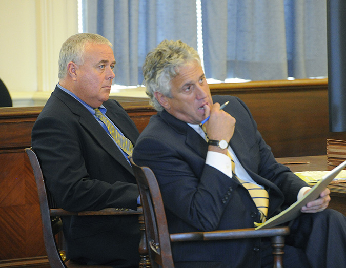 Donald Hill, left, and his attorney Gary Prolman listen to prosecutors' opening arguments at York County Superior Court in Alfred on Monday.