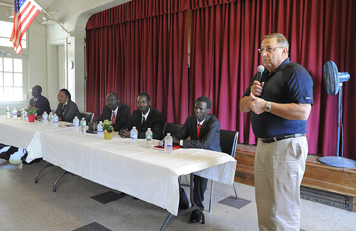 Gov. Paul LePage speaks to members of the Sudanese community at Trinity Episcopal Church in Portland on Friday.