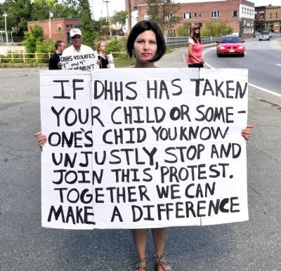 BethMarie Retamozzo protests against the state Department of Health and Human Services in Skowhegan in this August 2012 photo. Retamozzo is accused of abducting her children during a supervised visit.