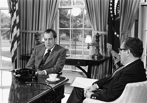President Richard Nixon talks with Secretary of State Henry Kissinger about the Middle East during a meeting at the White House in October 1973.