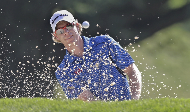 David Hearn of Canada hits out of a bunker on the ninth hole during the first round of the PGA Championship golf tournament at Oak Hill Country Club on Thursday in Pittsford, N.Y.