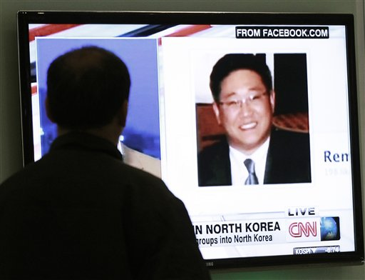 "A South Korean man watches a television news program showing Korean American Kenneth Bae at the Seoul Railway Station in South Korea in this May 2, 2013, photo. Bae has been sentenced by North Korea to 15 years of hard labor for ""hostile acts"" against the state."