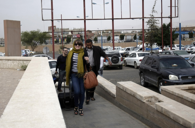 Travelers make their way to the departure lounge at Sanaa International Airport in Yemen on Tuesday. The State Department ordered non-essential personnel at the U.S. Embassy in Yemen to leave the country.