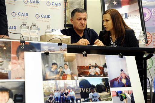 Abdulbaki Todashev, left, the father of Ibragim Todashev, listens, through interpreter Viktoryia Johnson, as his attorneys describe their quest for information into the shooting death of Ibragim during a press conference at an office for the Council on American-Islamic Relations Florida on Tuesday in Tampa, Fla.