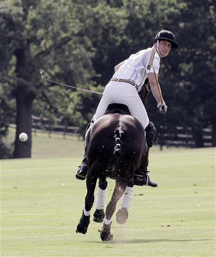 Britain's Prince William plays in a charity polo match, at Coworth Park, near Ascot, England, Saturday. Prince William played alongside brother Prince Harry.