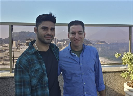In this undated photo released by Janine Gibson of The Guardian, Guardian journalist Glenn Greenwald, right, and his partner David Miranda, are shown together at an unknown location. Miranda, the partner of Greenwald, a journalist who received leaks from former National Security Agency contractor Edward Snowden, was detained for nearly nine hours Sunday under anti-terror legislation at Heathrow Airport, triggering claims that authorities are trying to interfere with reporting on the issue.