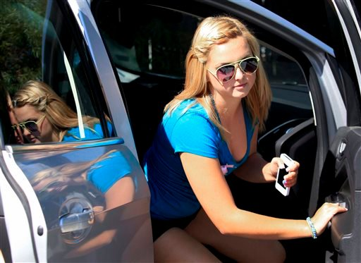 In this Aug. 15, 2013, photo, Hannah Anderson arrives at a fundraiser in her honor to raise money for her family, in Lakeside, Calif.
