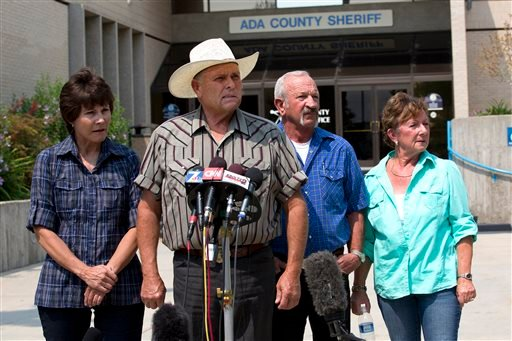 Standing in front of the Ada County Sheriff's Office in Boise, witnesses, from left to right, Mary Young, Mike Young, Mark John and Christa John speak with news reporters Sunday about their sighting of Hannah Anderson and James DiMaggio at Morehead Lake.