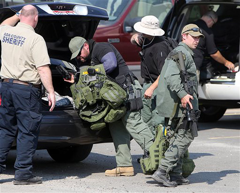 Law enforcement personnel head into the Valley County Emergency Operations Center during a search for James DiMaggio on Saturday in Cascade, Idaho.