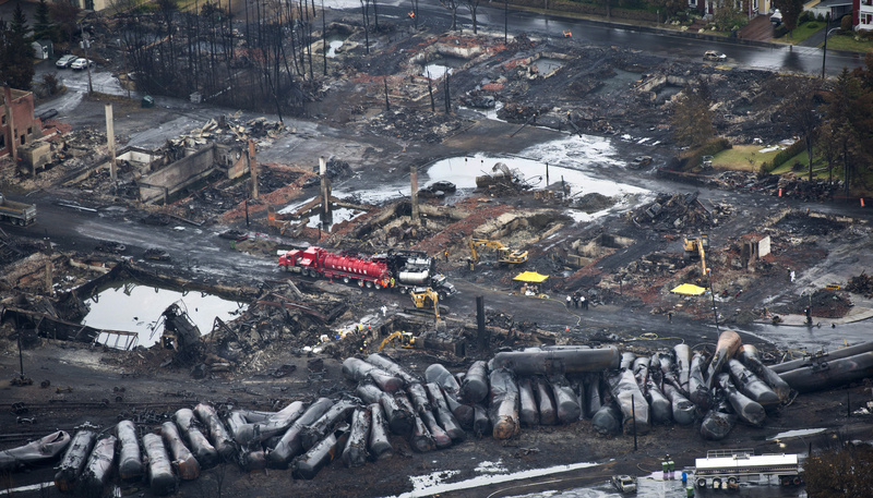 Workers comb through debris July 9, three days after a runaway train derailed, causing explosions, fire and destoying parts of Lac-Megantic, Quebec. Canada