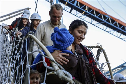 Hannah Gastonguay, holding her baby, Rahab, is followed by her husband, Sean, and the couple's 3-year-old daughter, Ardith, as they disembark in the port city of San Antonio, Chile, on Friday. The northern Arizona family was lost at sea for weeks in an ill-fated attempt to leave the U.S. over what they consider government interference in religion. But just weeks into their journey, the Gastonguays hit a series of storms that damaged their small boat, leaving them adrift for weeks. They were eventually picked up by a Venezuelan fishing vessel, transferred to a Japanese cargo ship and taken to Chile where they are resting in a hotel in San Antonio.