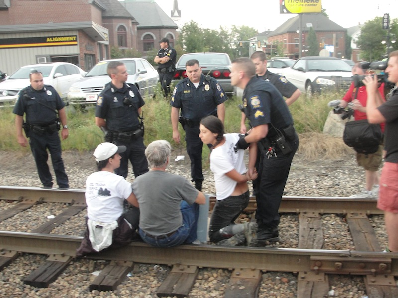 Three people were arrested Wednesday, Aug. 28, 2013 after staging an oil-train protest on railroad tracks in downtown Auburn, Maine.