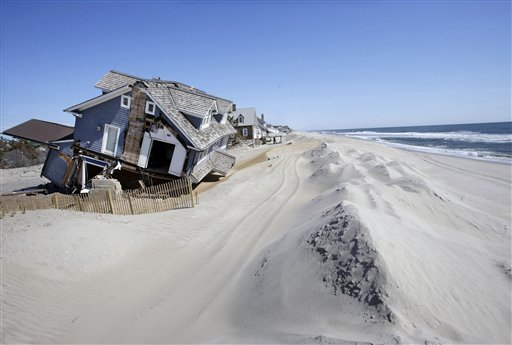 In this April 25, 2013, file photo, homes severely damaged last October by Superstorm Sandy, are seen along the beach in Mantoloking, N.J.