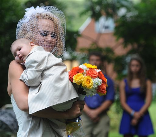 Christine Swidorsky carries her son and the couple's best man, Logan Stevenson, 2, down the aisle to her husband-to-be Sean Stevenson during the wedding ceremony in Jeannette, Pa. on Aug. 2. Christine Swidorsky Stevenson says on her Facebook page that Logan died in her arms at 8:18 p.m. Aug. 5, at their home in Jeannette, about 25 miles east of Pittsburgh.