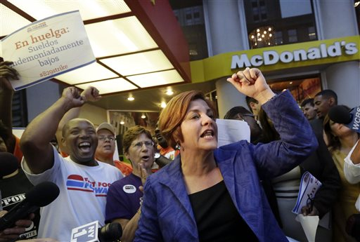 New York City Council Speaker and mayoral candidate Christine Quinn speaks at a fast-food workers' protest outside a McDonald's restaurant on New York's Fifth Avenue on Thursday.