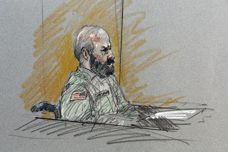 In this courtroom sketch, Maj. Nidal Malik Hasan sits in court for his court-martial Tuesday in Forth Hood, Texas.