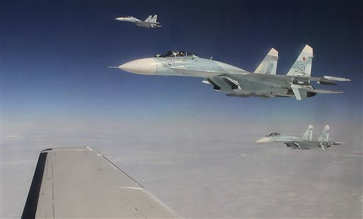 This Tuesday photo taken over the Bering Strait near Alaska shows three Russian Federation Air Force SU-27s intercepting a passenger plane that was hijacked during a simulation to test the response of NORAD and Russian Federation forces.