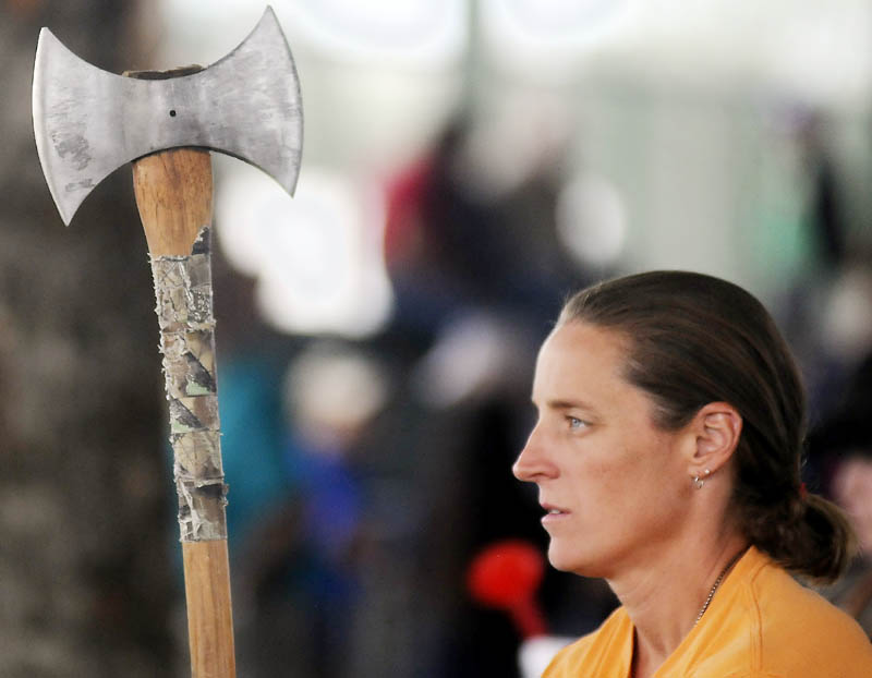 Michelle Morse prepares to launch an ax during a throwing competition today at the Windsor Fair Woodsmen's Field Day.