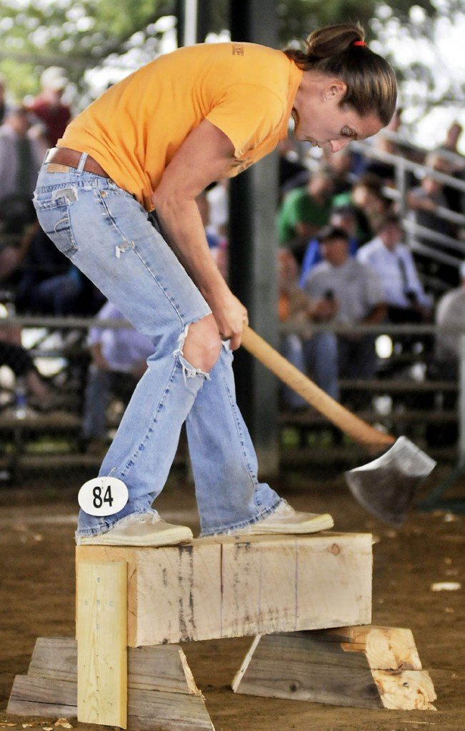 Michelle Morse competes in a wood cutting event today during the Windsor Fair Woodsmen's Field Day. Morse, of Eastbrook, is the world champion in the lumberjill standing block chop competition.