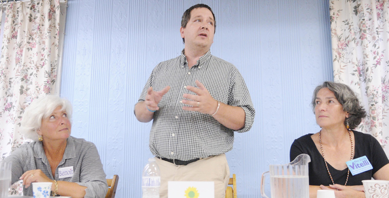 Green Party Senate District 19 candidate Daniel Stromgren addresses guests to the forum held Wednesday at the Enterprise Grange in Richmond. Stromgren, Republican candidate Paula Benoit, left, and Democrat Eloise Vitelli each spoke to the crowd.