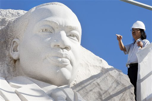 """Sculptor Lei Yixin surveys the Martin Luther King Jr. Memorial in Washington to prepare for removal of the """"Drum Major"""" inscription. The plan calls for completion of the work in time for the 50th anniversary of the March on Washington. The memorial will remain open during the work, although access to some areas of the memorial will be affected."""