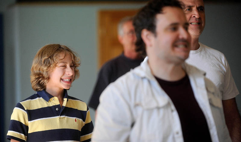 """Gabriel Lessing, 13, practices with some voice exercises during auditions for """"Fiddler on the Roof,"""" at the Waterville Opera House dance studio on Main Street in Waterville today."""