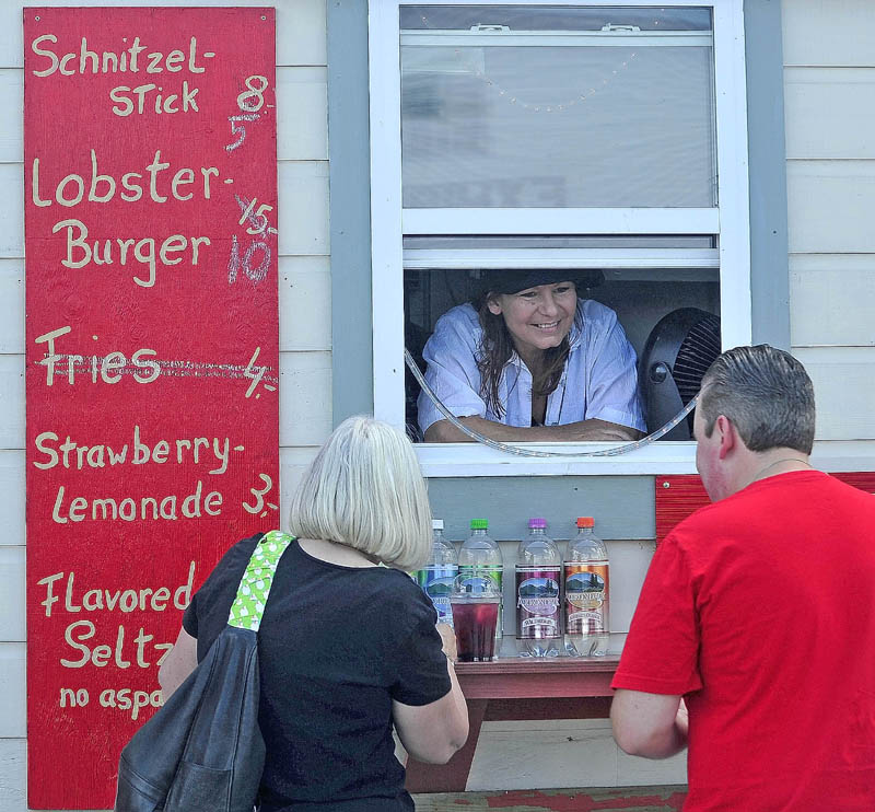 Johanna Franz, of Trescott, serves customers at her Sunny-Waters Grille cart at the 195th annual Skowhegan State Fair at the Skowhegan Fairgrounds today. Franz's cuisine celebrates her German-American heritage.