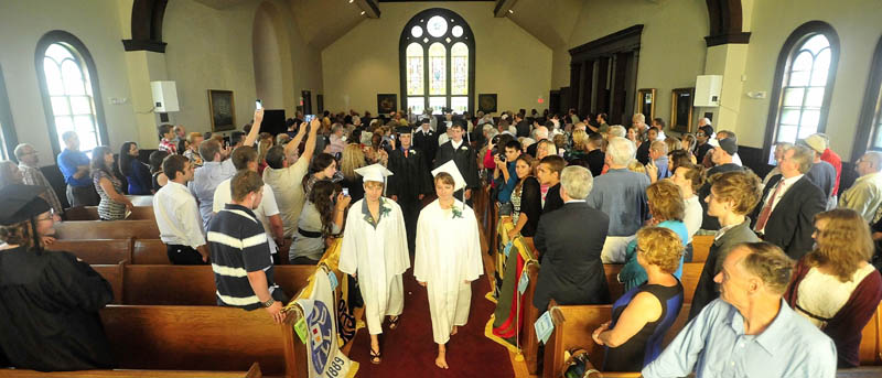 The first graduating class of the Maine Academy of Natural Sciences marches down the aisle at Moody Chapel in Hinckley during the inaugural commencement event today.