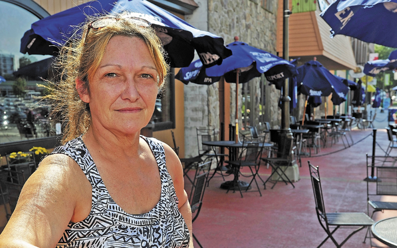 Cheryl Pellerin, a bartender at The Last Unicorn on Silver Street in Waterville, says Hector Fuentes is a great person and 'wonderful' neighbor.