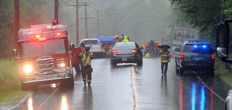 Authorities at the scene of a fatal accident involving a car and tractor trailer on Route 27 in New Vineyard on Friday.