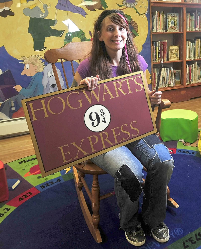 Alyssa Patterson, 33, a librarian at Lawrence Public Library, dresses up as her favorite Harry Potter character, Nymphadora Tonks, on Thursday. Patterson submitted the library's winning application to be one of the 15 locations that will participate in a Harry Potter 15-year anniversary celebration party.
