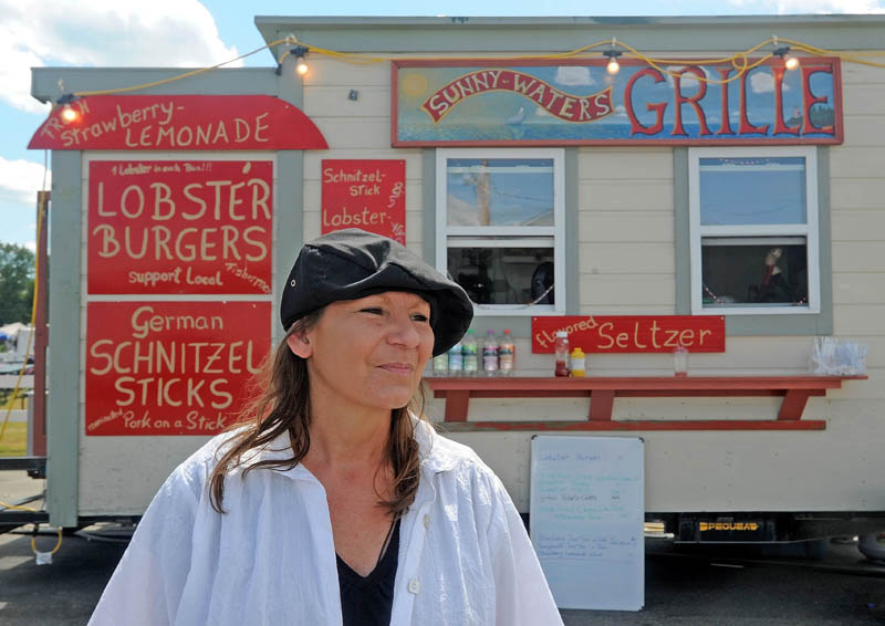 Johanna Franz, of Trescott, stands by her Sunny-Waters Grille cart at the 195th annual Skowhegan State Fair at the Skowhegan Fairgrounds today.