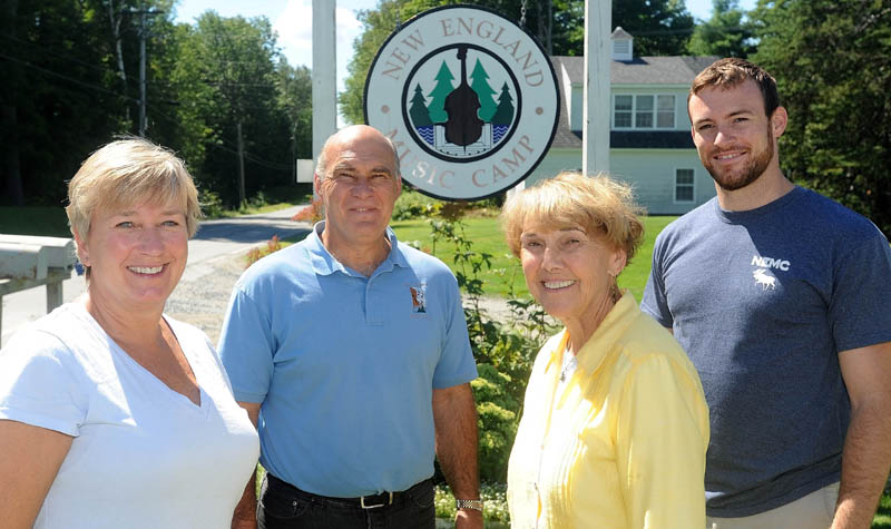 Jeanette Wiggin, director emeritus, second from right, with her grandson, Matthew, right; son, John, left center; and daughter-in-law, Kim, far left, at the entrance to the family's New England Music Camp in Sidney. The music camp has lasted over four generations in the Wiggin family and is wrapping up its 77th summer.