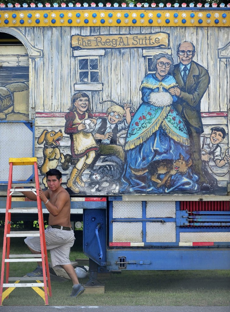 Gomzalo Calitto, 23, of Mexico, sets up the fun house as Fiesta Shows prepares for the Skowhegan State Fair at the Skowhegan Fairgrounds today.