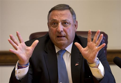 This June 2 file photo shows Gov. Paul LePage speaking to reporters shortly after the Maine House and Senate both voted to override his veto of the state budget at the State House in Augusta. LePage's off-color remarks have offended opponents, galvanized supporters and fueled attacks from the Democratic congressman and independent candidate hoping to unseat him in 2014. But the three-way race shaping up may once again play into LePage's favor.