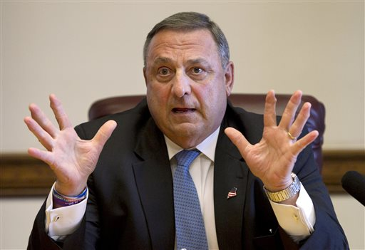 """In this June 26, 2013 file photo, Gov. Paul LePage speaks to reporters. LePage denied Tuesday that he said during a private fundraiser last week that President Obama """"hates white people,"""" but two Republicans at the event confirm hearing it."""
