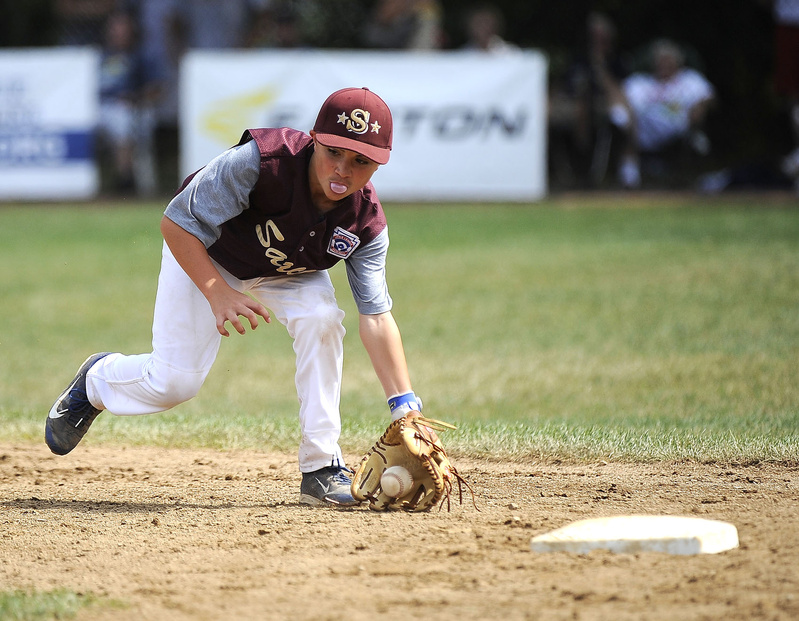 Saco's Luke Chessie blows a bubble while fielding a ground ball during the New England semifinal at the 2013 Eastern Regional Little League Tournament at Breen Field in Bristol, Conn., on Thursday.