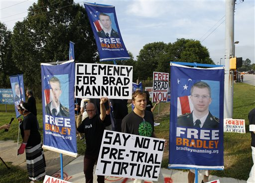 Supporters of Army Pfc. Bradley Manning hold up banners and signs as they protest outside of the gates at Fort Meade, Md., Wednesday, before a sentencing hearing in Manning's court martial.