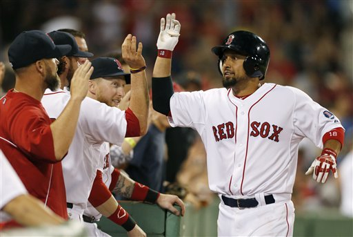 Boston Red Sox outfielder Shane Victorino, right, celebrates his solo home run in the eighth inning off Seattle Mariners pitcher Charlie Furbush on Thursday at Fenway Park in Boston. The Red Sox won 8-7.