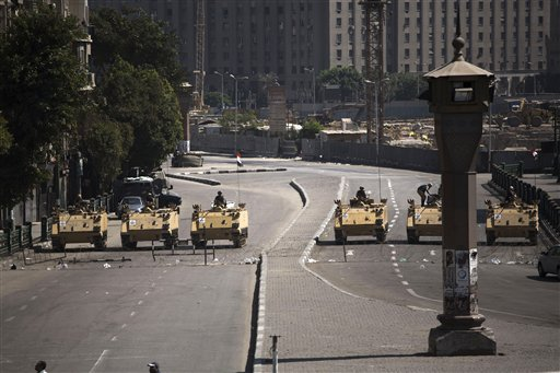 Egyptian army soldiers in armored vehicles block Tahrir Square in Cairo on Friday.