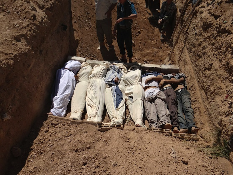 """This Aug. 21, 2013, file image provided by by Shaam News Network, which has been authenticated based on its contents and other AP reporting, purports to show several bodies being buried during a funeral in a suburb of Damascus, Syria. A senior administration official said Sunday, Aug. 25, 2013, that there is """"very little doubt"""" that a chemical weapon was used by the Syrian regime against civilians in an incident that killed at least a hundred people last week, but added that the president had not yet decided how to respond. (AP Photo/Shaam News Network, File)"""