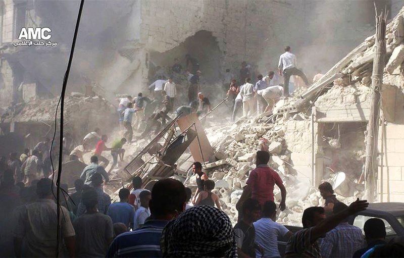 In this citizen journalism image, which has been authenticated based on its contents and other AP reporting, Syrians inspect the rubble of damaged buildings due to heavy shelling by Syrian government forces in Aleppo, Syria, on Monday.