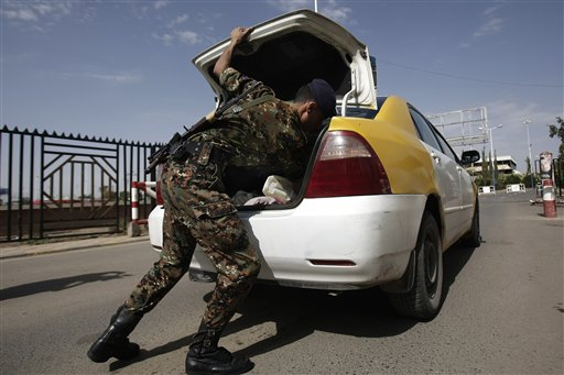 A policeman checks a car at the entrance of Sanaa International Airport, in Yemen on Wednesday. The State Department on Tuesday ordered non-essential personnel at the U.S. Embassy in Yemen to leave the country.