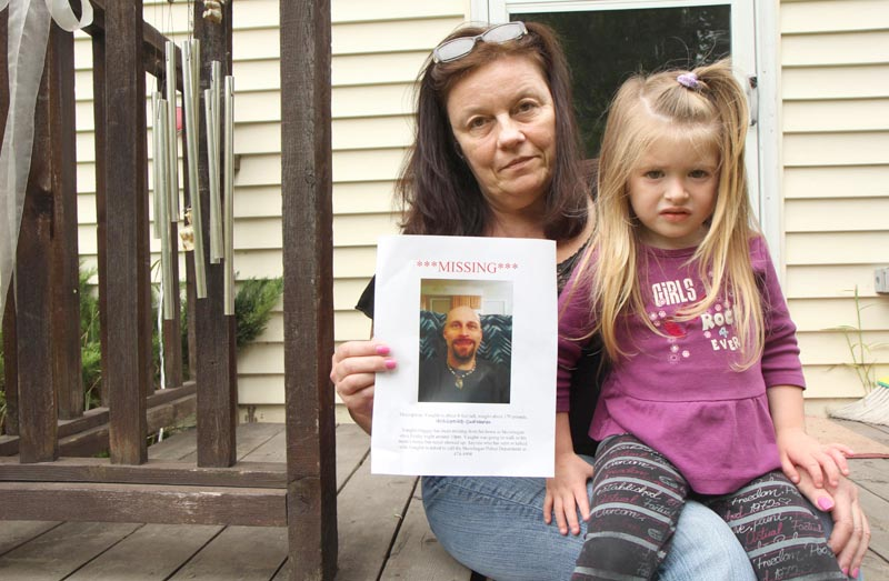 Rosanne Dubay, with her 3-year-old granddaughter, Arrienna Bowring, holds a photo of her missing son, Vaughn Giggey III, at her home in Skowhegan today. Several law enforcement agencies, along with friends and family, are looking for Giggey, who was last seen Friday night.