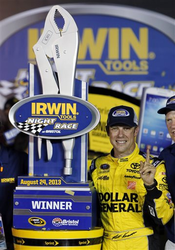 Matt Kenseth stands with the trophy after winning the NASCAR Sprint Cup Series auto race, Saturday, Aug. 24, 2013, at Bristol Motor Speedway in Bristol, Tenn. (AP Photo/Wade Payne) Irwin Tools Night Race;Bristol Motor Speedway